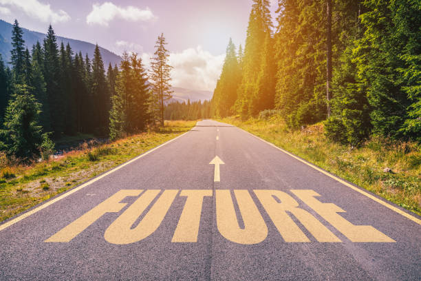 future text on road against asphalt background in nature. - looking ahead stock photos and pictures