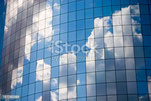 istock Futuristic abstract business background with reflected blue skies and clouds 157283393