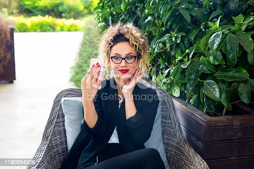 851960142istockphoto Futuristic and technological scanning of the face of a beautiful woman for facial recognition and scanned person. It can serve to ensure personal safety. Concept of: future, security, scanning. 1180564326
