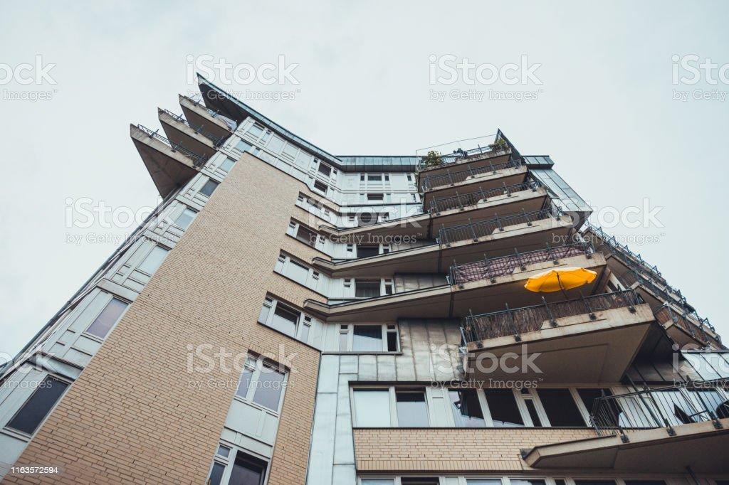 futuristic apartment house on grey background