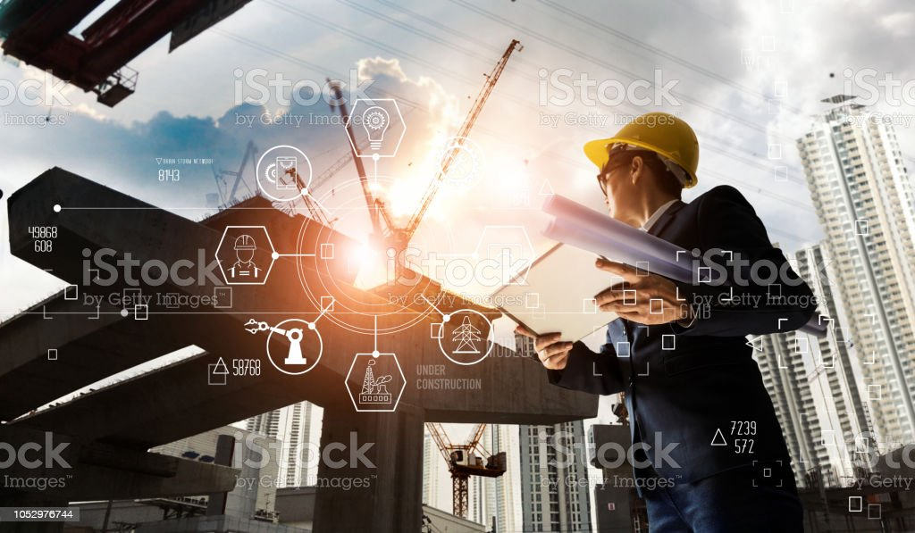 A futuristic architect, Businessman, Industry 4.0. Engineer manager using tablet with icon network connection in construction site, Industrial and innovation. Industry technology concept. stock photo