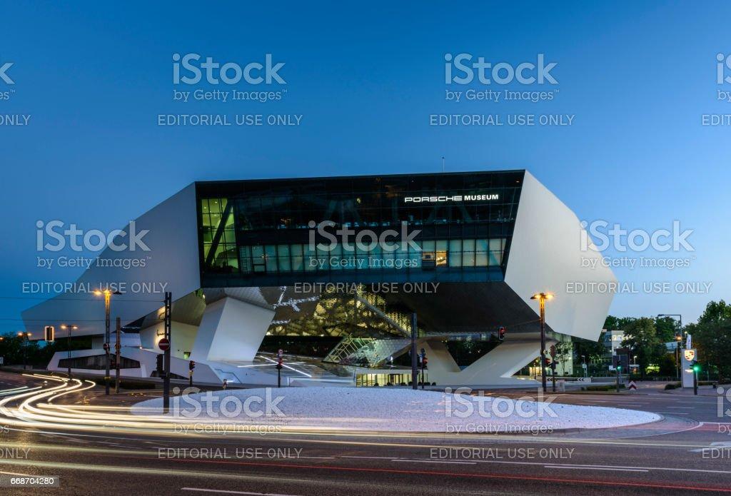 Futuristic architecture night traffic blur Porsche Museum stock photo