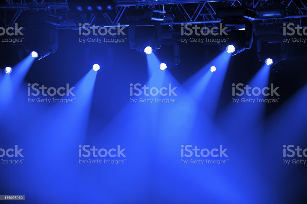 Futuristic blue spotlights on stage stock photo