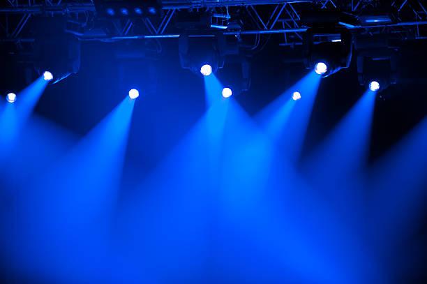 Futuristic blue spotlights on stage stock photo