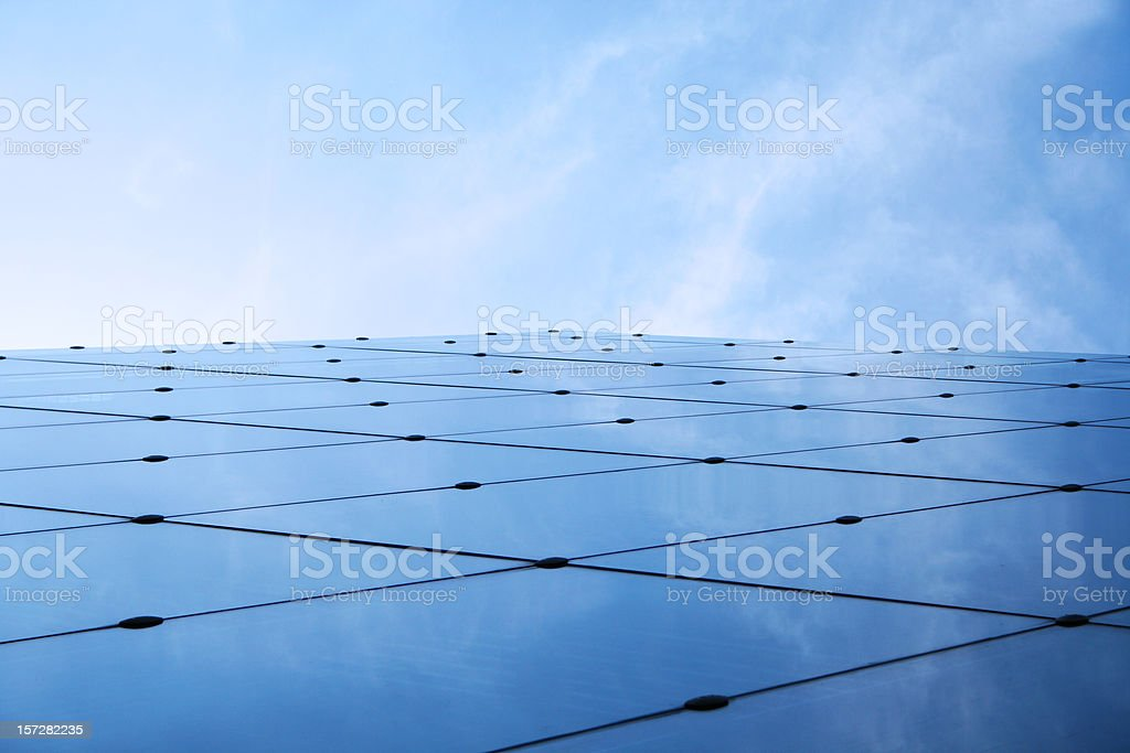 Futuristic business abstract: glass horizon with blue sky stock photo