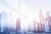 futuristic business background, double exposure of office window and city skyline