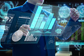 Businessman holding futuristic virtual modern computer augmented reality touch screens analysing on investment risk management and return on investment analysis