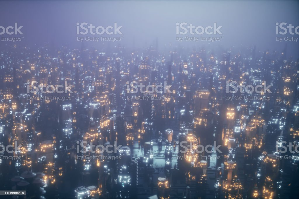 Futuristic city at night in the fog, the city of the future is...