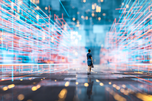 Futuristic city VR wire frame with businesswoman walking. 3D generated image.