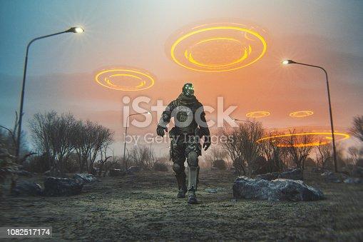 Futuristic cyborg walking in desert with flying UFOs.