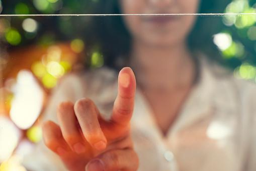 futuristic digital processing of biometric fingerprint scanner. concept of surveillance and security scanning of digital programs and fingerprint biometrics. cyber futuristic applications, future.