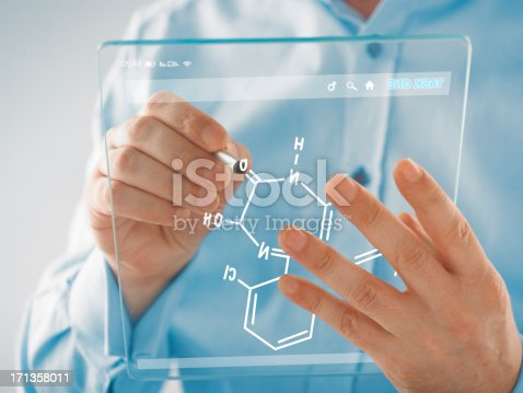 man writing on a futuristic transparent digital tablet