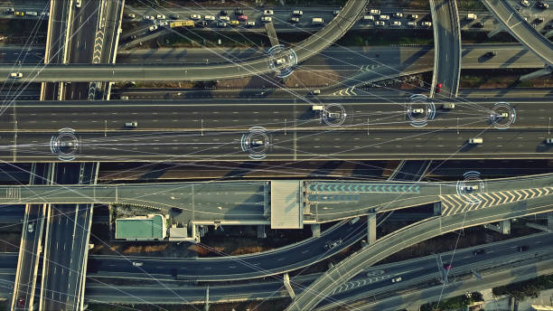 Futuristic Driverless Cars on the Elevated Expressway Aerial view from above of traffic on the elevated expressway with futuristic autonomous, driverless cars using artificial intelligence computer network and satellite gps for navigation concept car stock pictures, royalty-free photos & images