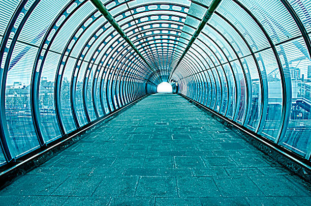 futuristic glass tunnel - walkway and bridge stock photos and pictures