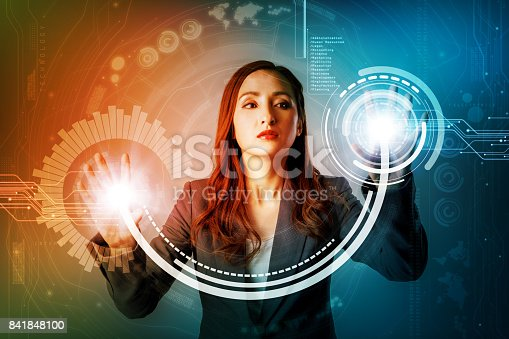 istock futuristic graphical user interface concept. businesswoman touching virtual screen. Internet of Things. Heads up display. technological abstract. 841848100