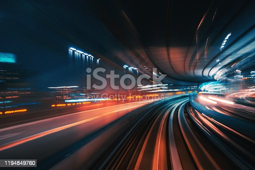 High Speed Motion Blur driving through a tunnel at night  Futuristic High Speed Monorail Train Tokyo, Japan