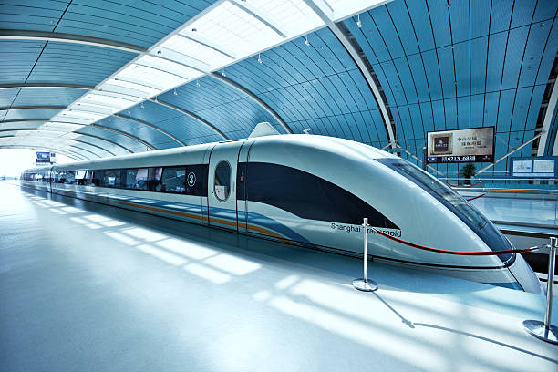 Futuristic high-speed train in China Shanghai, China - October 04, 2009: Shanghai Maglev Train or Shanghai Transrapid is a magnetic levitation train, the fastest passenger train currently in service (431km/h). The line runs from Longyang Road station in Pudong to Pudong International Airport. bullet train stock pictures, royalty-free photos & images