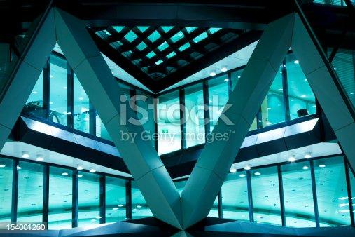 istock Futuristic Illuminated Office Building at Night 154001250