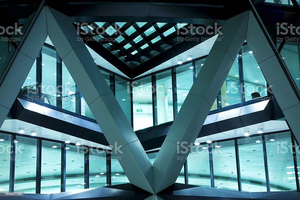 Futuristic Illuminated Office Building at Night stock photo