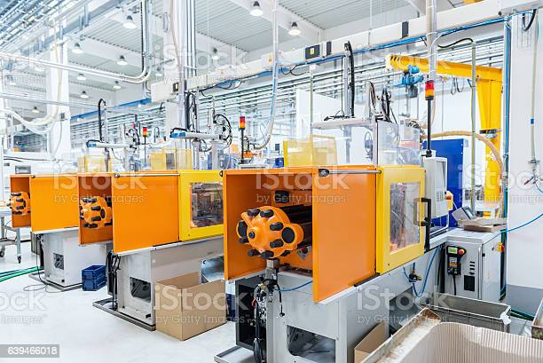 Futuristische Spritzgießmaschinen Stockfoto und mehr Bilder von Fabrik