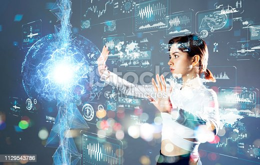 istock Futuristic interface and an engineer. 1129543786
