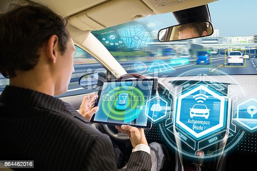 istock Futuristic interface of autonomous car. Self driving vehicle. Driverless car. 864462016
