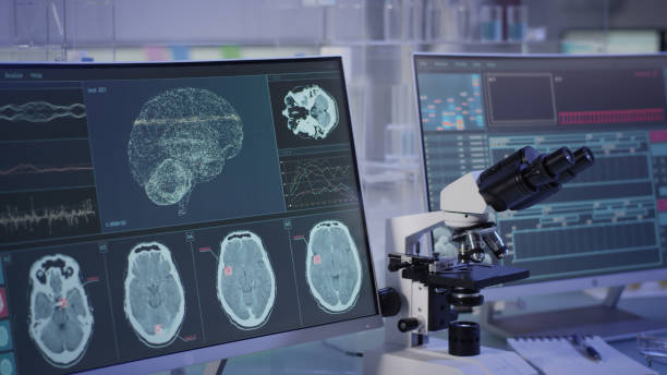 Futuristic laboratory equipment. Brainwave scanning research on computer screens stock photo
