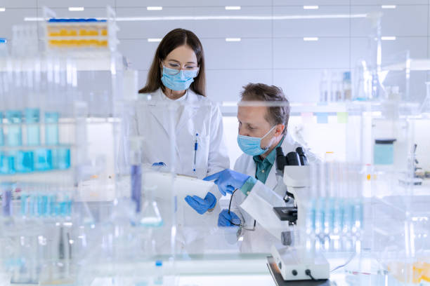Futuristic laboratory equipment. Team studying medical samples using microscope Modern laboratory interior. Genetic Research Laboratory dna purification stock pictures, royalty-free photos & images