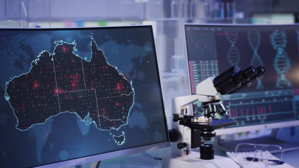 Futuristic laboratory. Virus spreading on Australia map. Scanning DNA mutations stock photo