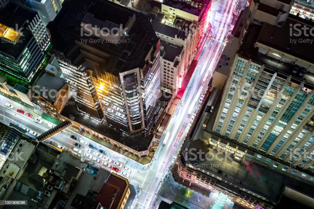 Futuristic lights of the streets of a busy city at night glow vividly stock photo