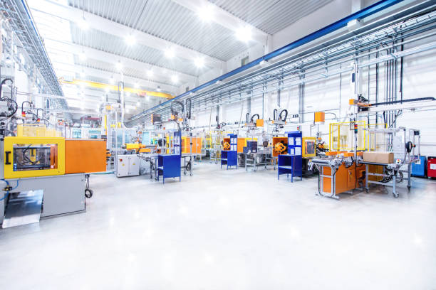 futuristic machinery in modern production line - industrial modern stock photos and pictures