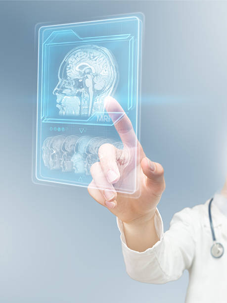 Futuristic MRI scan Doctor using virtual interface displaying brain scan neuroscience patient stock pictures, royalty-free photos & images