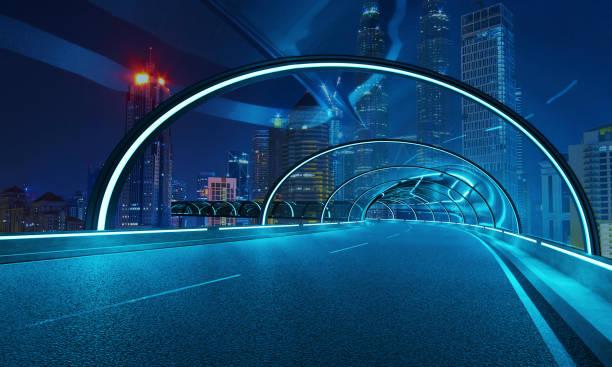 Futuristic neon light and glass facade design of tunnel flyover road stock photo