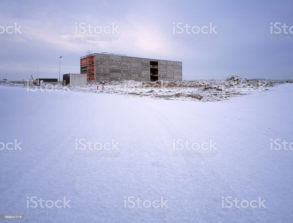 Futuristic office building at development area in winter stock photo
