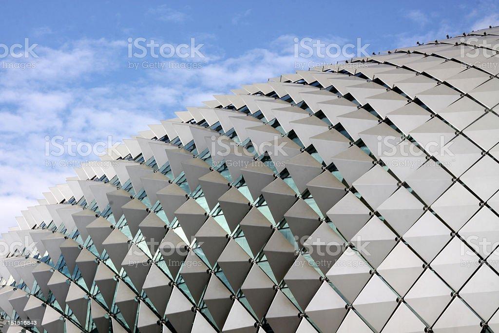 Futuristic opera house roof against blue sky stock photo
