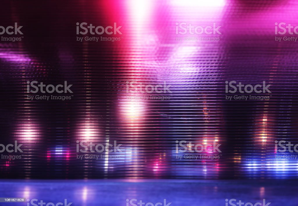 Futuristic pink and purple neon night lights of the city stock photo