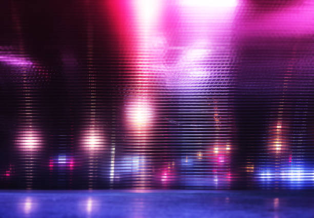 Futuristic pink and purple neon night lights of the city stock photo