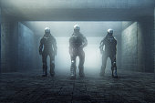 Futuristic police cyborgs walking in old corridor