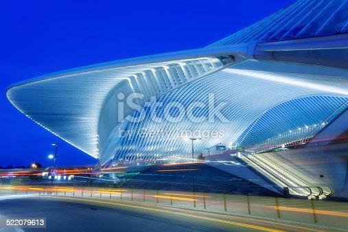 futuristic building of a railway station illuminated at night, Liege, Guillemins, Belgium