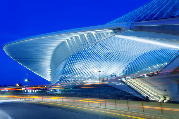 Futuristic Railway Station Building Illuminated at Night futuristic building of a railway station illuminated at night, Liege, Guillemins, Belgium lulik stock pictures, royalty-free photos & images