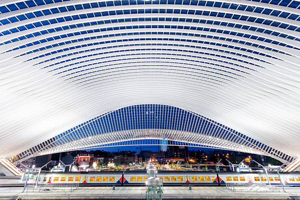 Futuristic Railway Station Illuminated at Night futuristic railway station illuminated at night, Liege, Guillemins, Belgium lulik stock pictures, royalty-free photos & images