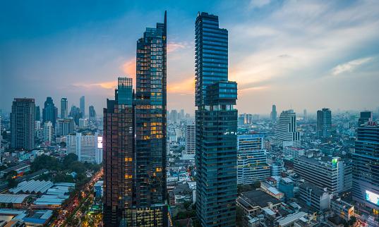 istock Futuristic skyscraper cityscape at sunset Bangkok highrise tower panorama Thailand 1136595535