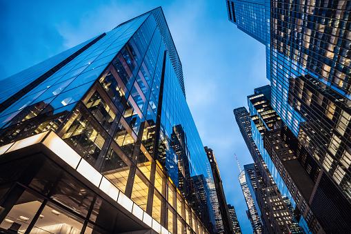 Night view of modern skyscrapers in Midtown Manhattan.