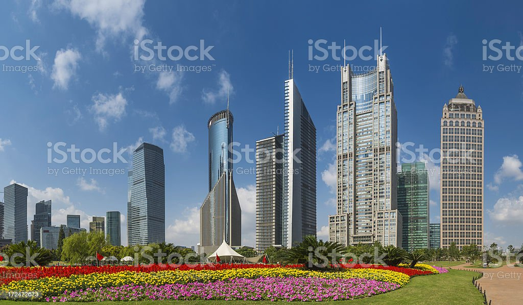 Futuristic skyscrapers gleaming over flower park Shangahi China royalty-free stock photo