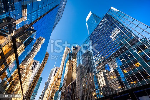 Futuristic skyscrapers in Midtown Manhattan on a sunny day.