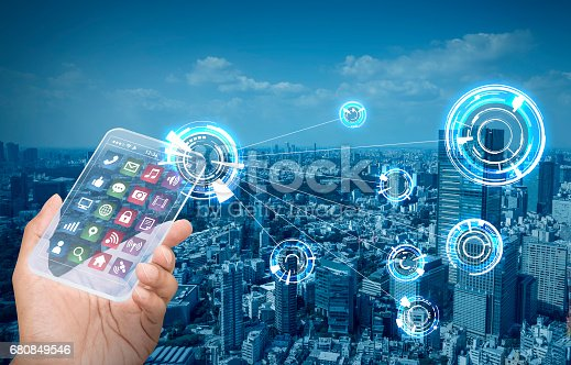 istock futuristic smart phone and wireless communication network, smart city, Internet of Things, abstract image visual 680849546