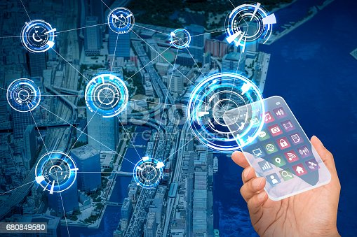 istock futuristic smart phone and wireless communication network, smart city, Internet of Things, abstract image visual 680849580