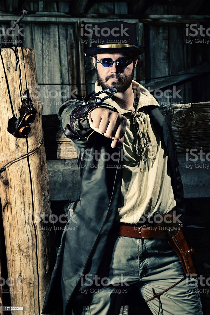 Futuristic Steampunk Warrior With Arm Weapon And Pistol stock photo
