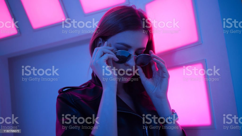 Futuristic style portrait in blue and purple light. stock photo