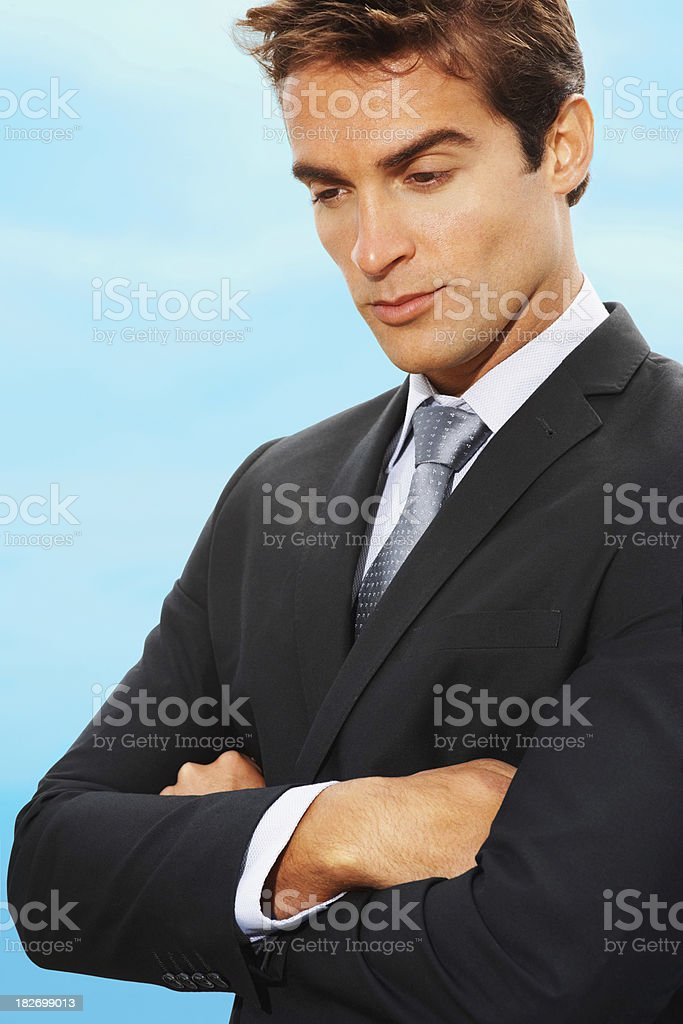 Futuristic thinking - Business man lost in creative thoughts royalty-free stock photo